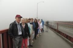 Group Standing On Golden Gate Bridge