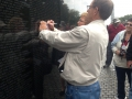 Tracing a name of a family friend at the Vietnam Memorial